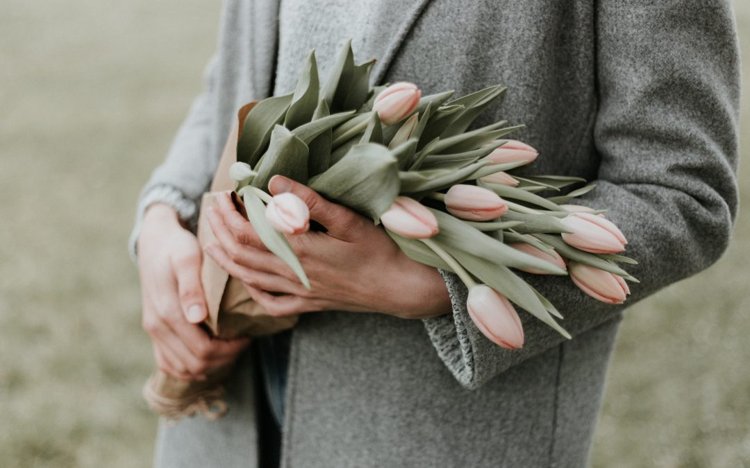 women holding pink tulips to give to mum